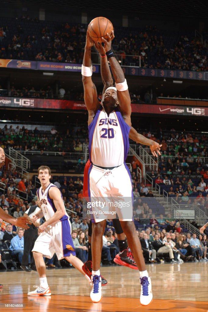 Jermaine O'Neal #20 of the Phoenix Suns grabs a rebound against the Milwaukee Bucks on January 17, 2013 at U.S. Airways Center in Phoenix, Arizona.