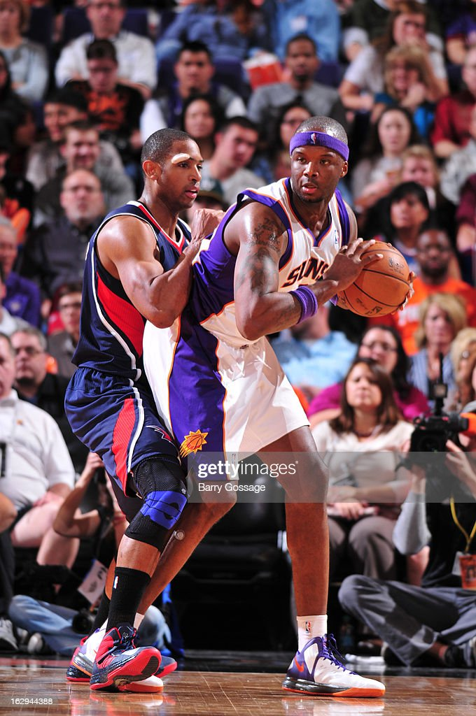 Jermaine O'Neal #20 of the Phoenix Suns is guarded by Al Horford #15 of the Atlanta Hawks on March 1, 2013 at U.S. Airways Center in Phoenix, Arizona.