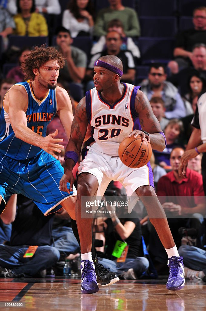 <a gi-track='captionPersonalityLinkClicked' href=/galleries/search?phrase=Jermaine+O%27Neal&family=editorial&specificpeople=201524 ng-click='$event.stopPropagation()'>Jermaine O'Neal</a> #20 of the Phoenix Suns is guarded by <a gi-track='captionPersonalityLinkClicked' href=/galleries/search?phrase=Robin+Lopez&family=editorial&specificpeople=2351509 ng-click='$event.stopPropagation()'>Robin Lopez</a> #15 of the New Orleans Hornets on November 23, 2012 at U.S. Airways Center in Phoenix, Arizona.