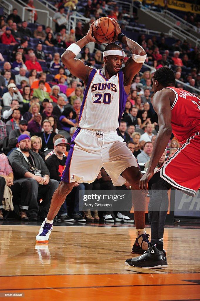 Jermaine O'Neal #20 of the Phoenix Suns looks to pass the ball against the Milwaukee Bucks on January 17, 2013 at U.S. Airways Center in Phoenix, Arizona.