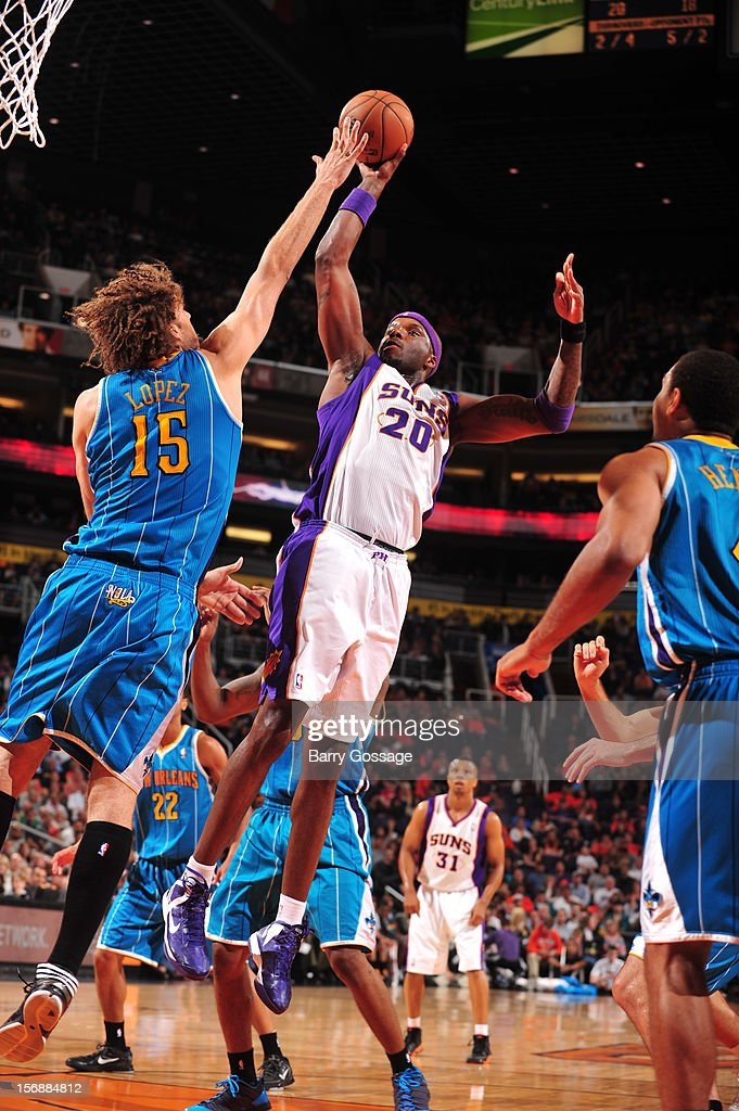 <a gi-track='captionPersonalityLinkClicked' href=/galleries/search?phrase=Jermaine+O%27Neal&family=editorial&specificpeople=201524 ng-click='$event.stopPropagation()'>Jermaine O'Neal</a> #20 of the Phoenix Suns puts a shot up over the block of <a gi-track='captionPersonalityLinkClicked' href=/galleries/search?phrase=Robin+Lopez&family=editorial&specificpeople=2351509 ng-click='$event.stopPropagation()'>Robin Lopez</a> #15 of the New Orleans Hornets on November 23, 2012 at U.S. Airways Center in Phoenix, Arizona.
