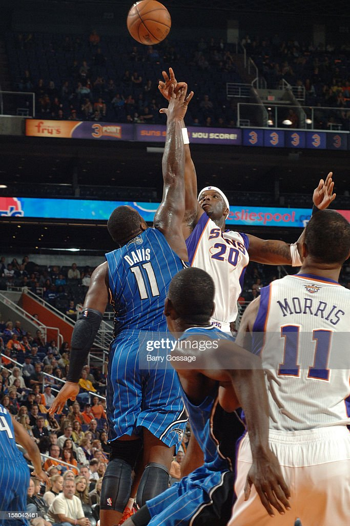 Jermaine O'Neal #20 of the Phoenix Suns puts a shot up over the block of Glen Davis #11 of the Orlando Magic on December 9, 2012 at U.S. Airways Center in Phoenix, Arizona.