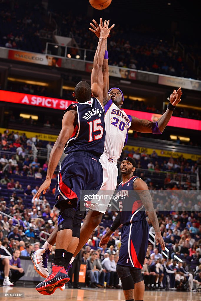 Jermaine O'Neal #20 of the Phoenix Suns shoots over Al Horford #15 of the Atlanta Hawks on March 1, 2013 at U.S. Airways Center in Phoenix, Arizona.