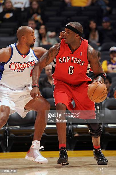 Jermaine O'Neal of the Toronto Raptors backs down in the low post against Brian Skinner of the Los Angeles Clippers at Staples Center on October 18...