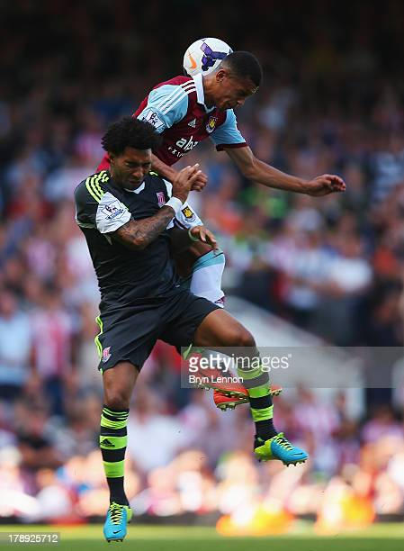 Jermaine Pennant of Stoke City and Ravel Morrison of West Ham United challenge for the ball during the Barclays Premier League match between West Ham...