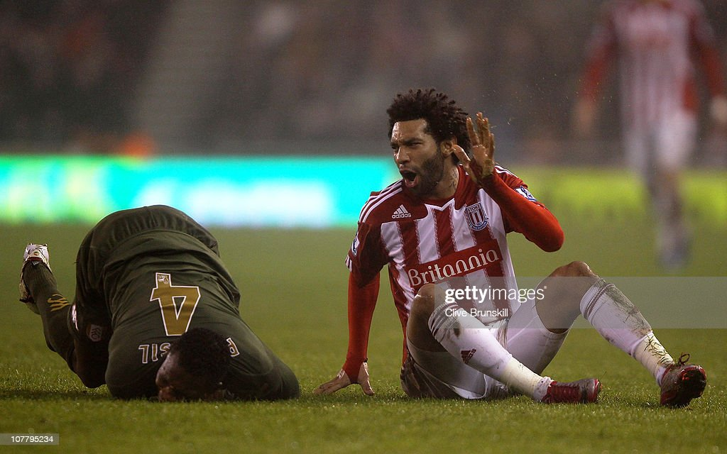 <a gi-track='captionPersonalityLinkClicked' href=/galleries/search?phrase=Jermaine+Pennant&family=editorial&specificpeople=206641 ng-click='$event.stopPropagation()'>Jermaine Pennant</a> of Stoke City holds his hand up after a challenge on <a gi-track='captionPersonalityLinkClicked' href=/galleries/search?phrase=John+Paintsil&family=editorial&specificpeople=613006 ng-click='$event.stopPropagation()'>John Paintsil</a> of Fulham during the Barclays Premier League match between Stoke City and Fulham at Britannia Stadium on December 28, 2010 in Stoke on Trent, England.