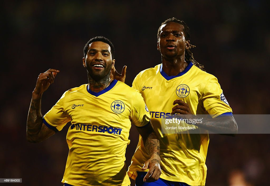 <a gi-track='captionPersonalityLinkClicked' href=/galleries/search?phrase=Jermaine+Pennant&family=editorial&specificpeople=206641 ng-click='$event.stopPropagation()'>Jermaine Pennant</a> of Wigan Athletic (L) celebrates with Gaetan Bong as he scores their first and equalising goal from a free kick during the Sky Bet Championship match between Fulham and Wigan Athletic at Craven Cottage on April 10, 2015 in London, England.