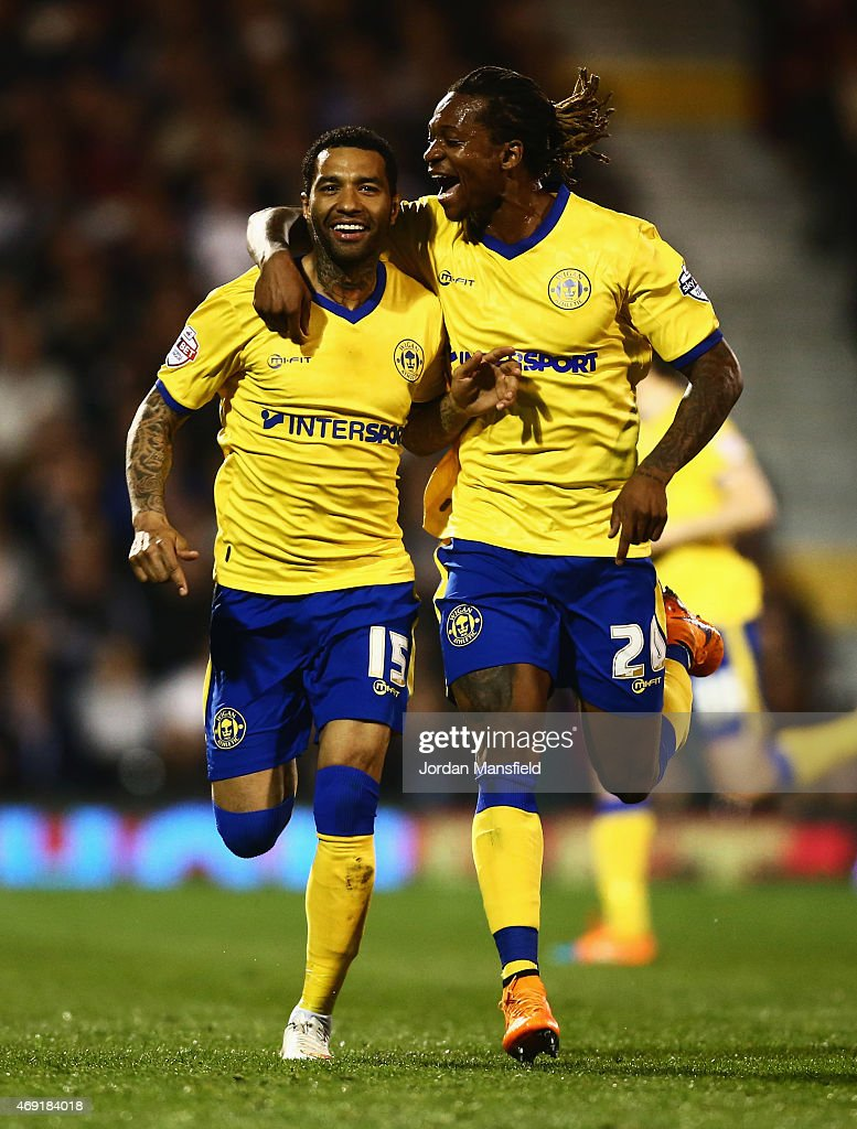 <a gi-track='captionPersonalityLinkClicked' href=/galleries/search?phrase=Jermaine+Pennant&family=editorial&specificpeople=206641 ng-click='$event.stopPropagation()'>Jermaine Pennant</a> of Wigan Athletic (L) celebrates with <a gi-track='captionPersonalityLinkClicked' href=/galleries/search?phrase=Gaetan+Bong&family=editorial&specificpeople=4094473 ng-click='$event.stopPropagation()'>Gaetan Bong</a> as he scores their first and equalising goal from a free kick during the Sky Bet Championship match between Fulham and Wigan Athletic at Craven Cottage on April 10, 2015 in London, England.