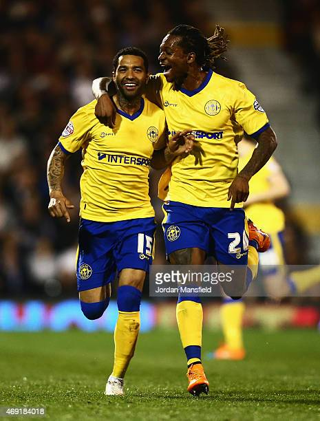 Jermaine Pennant of Wigan Athletic celebrates with Gaetan Bong as he scores their first and equalising goal from a free kick during the Sky Bet...