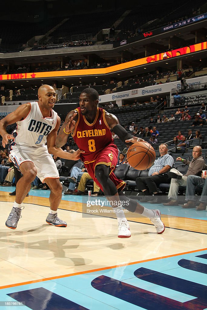 <a gi-track='captionPersonalityLinkClicked' href=/galleries/search?phrase=Jermaine+Taylor+-+Basketball+Player&family=editorial&specificpeople=13524203 ng-click='$event.stopPropagation()'>Jermaine Taylor</a> #8 of the Cleveland Cavaliers drives against Gerald Henderson #9 of the Charlotte Bobcats during the game at the Time Warner Cable Arena on October 24, 2013 in Charlotte, North Carolina.