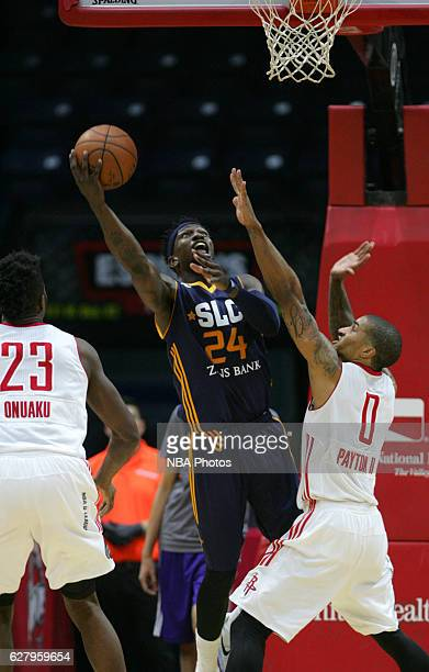 Jermaine Taylor of the Salt Lake City Stars shoots the ball against Gary Payton II of the Rio Grande Valley Vipers at the State Farm Arena December 5...