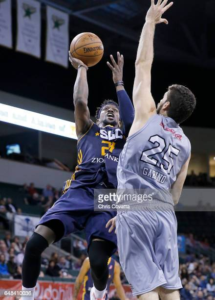 Jermaine Taylor of the Salt Lake City Stars shoots the ball against Patricio Garino of the Austin Spurs at the HEB Center At Cedar Park on March 5...