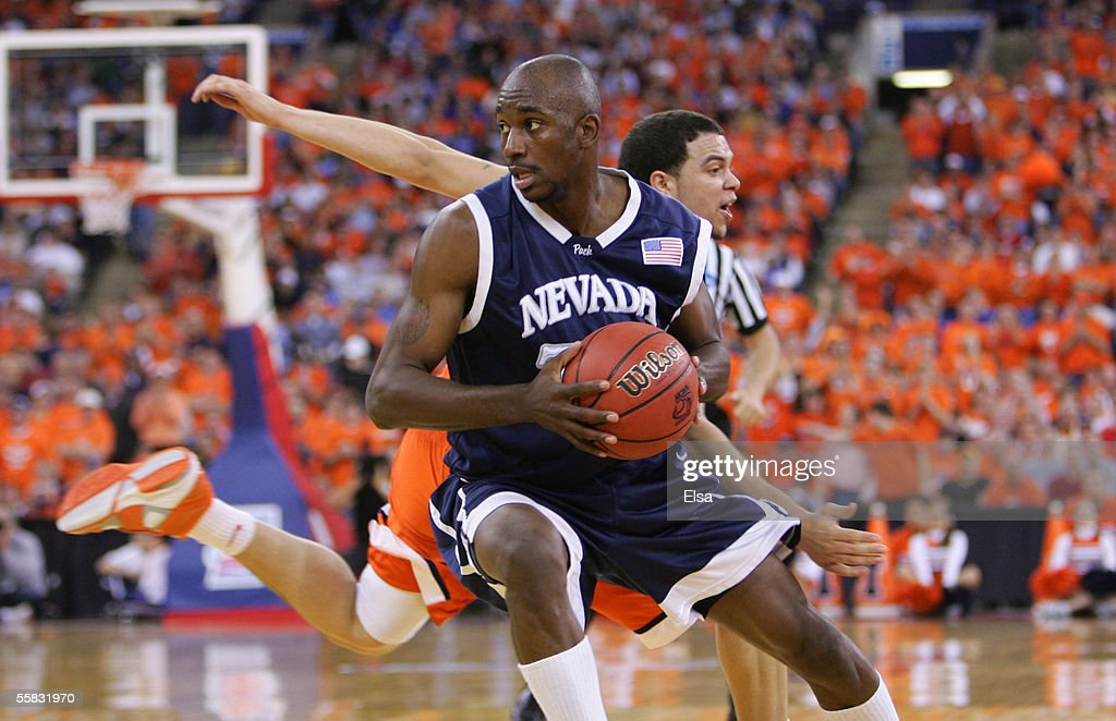 Jermaine Washington of the Nevada Wolf Pack drives past Deron Williams of the Illinois Fighting Illini in the second round of the NCAA Division I...