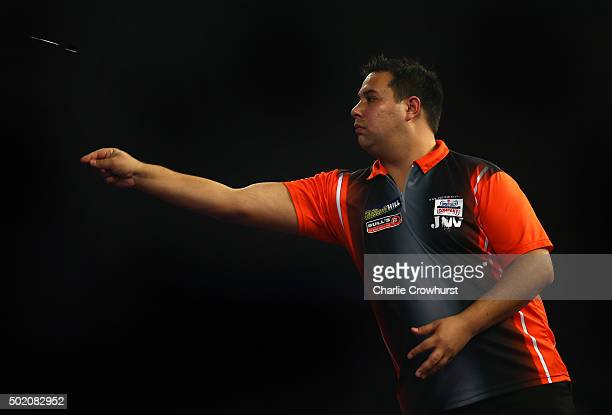 Jermaine Wattimena of Holland in action during his first round match against Mensur Suljovic of Austria during the 2016 William Hill PDC World Darts...
