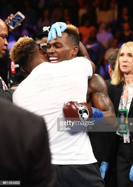 Jermell Charlo celebrates with his brother Jermall after his first round knockout against Erickson Lubin during their WBC Junior Middleweight Title...