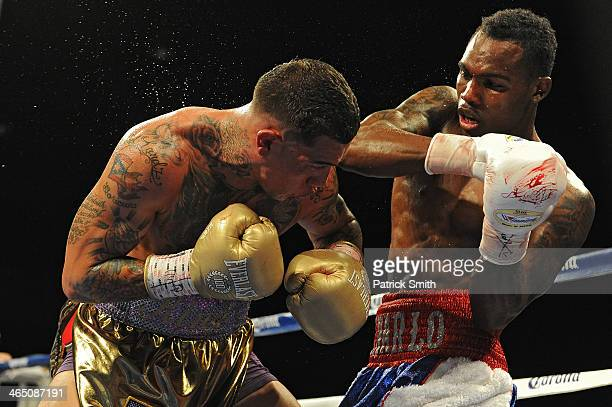Jermell Charlo hits Gabriel Rosado in their WBC Continental Americas Title match at the DC Armory on January 25 2014 in Washington DC