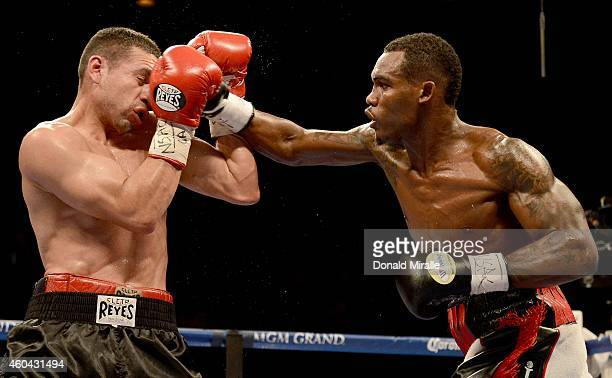 Jermell Charlo hits Mario Lozano during their junior welterweight fight at the MGM Grand Garden Arena on December 13 2014 in Las Vegas Nevada Charlo...
