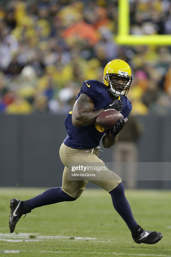 <a gi-track='captionPersonalityLinkClicked' href=/galleries/search?phrase=Jermichael+Finley&family=editorial&specificpeople=3047554 ng-click='$event.stopPropagation()'>Jermichael Finley</a> #88 of the Green Bay Packers makes the catch before running out of bounds during the second half of action against the Cleveland Browns at Lambeau Field on October 20, 2013 in Green Bay, Wisconsin.