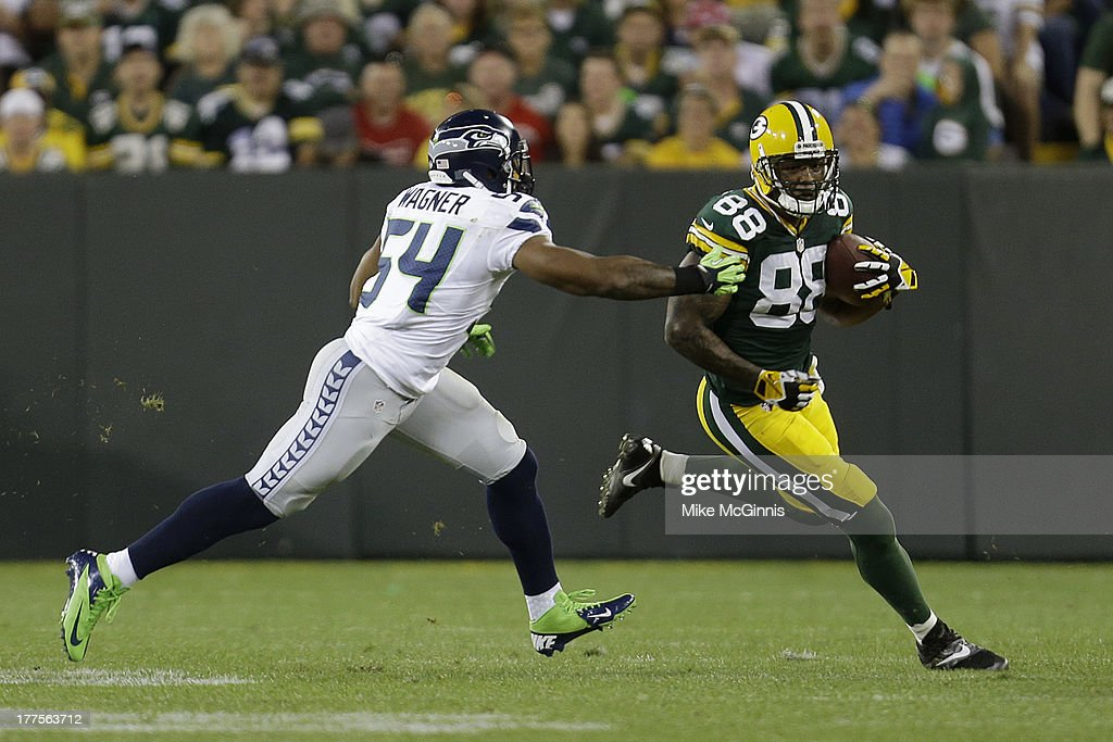 <a gi-track='captionPersonalityLinkClicked' href=/galleries/search?phrase=Jermichael+Finley&family=editorial&specificpeople=3047554 ng-click='$event.stopPropagation()'>Jermichael Finley</a> #88 of the Green Bay Packers runs for yardage before being tackled by Bobby Wagner #54 during the game against the Seattle Seahawks at Lambeau Field on August 23, 2013 in Green Bay, Wisconsin.