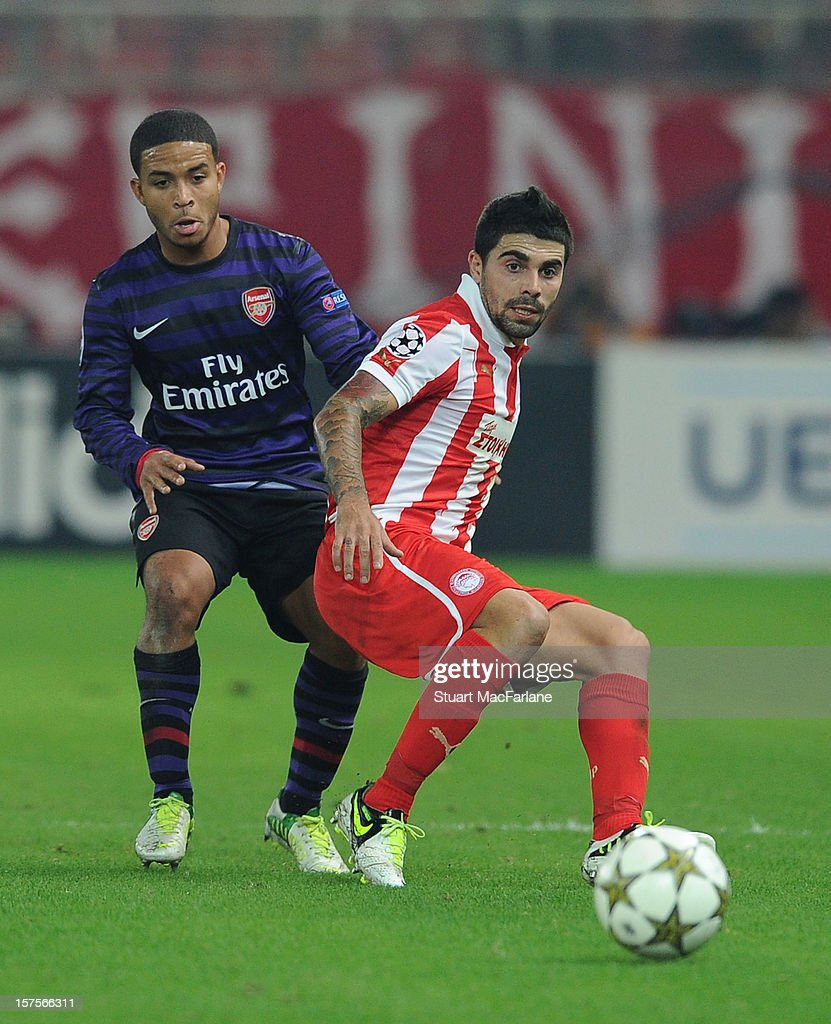 Jernade Meade of Arsenal challenges Paulo Maniatis of Olympiacos during the UEFA Champions League Group B match between Olympiacos FC and Arsenal FC at Georgios Karaiskakis Stadium on December 04, 2012 in Athens, Greece.