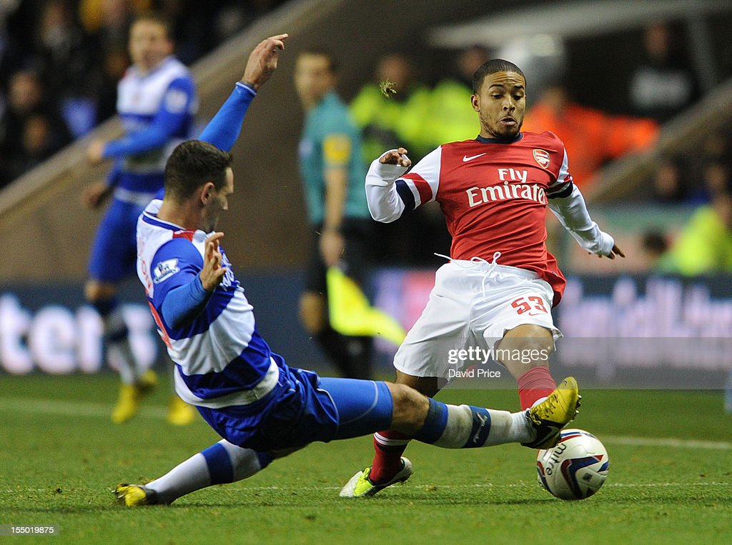 Jernade Meade of Arsenal challenges Sean Morrison of Reading during the Capital One Cup match between Arsenal and Reading at Madejski Stadium on October 30, 2012 in Reading, England.