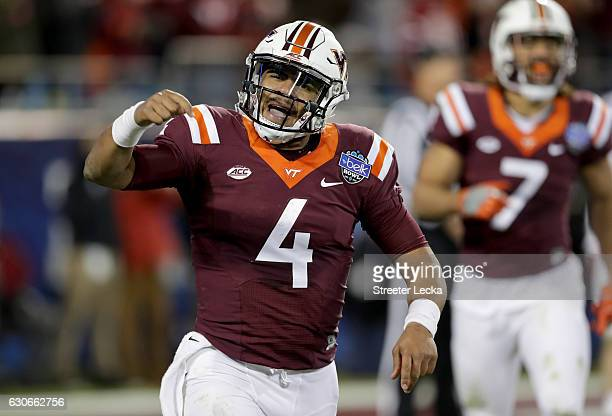 Jerod Evans of the Virginia Tech Hokies celebrates after a touchdown against the Arkansas Razorbacks during the Belk Bowl at Bank of America Stadium...