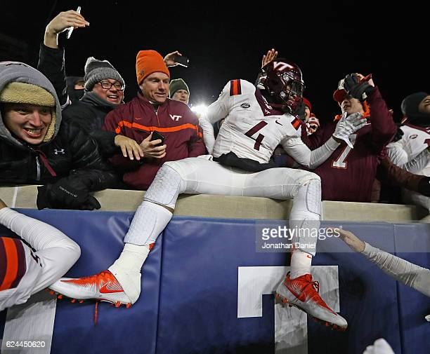 Jerod Evans of the Virginia Tech Hokies celebrates in the stands with fans after a win over the Notre Dame Fighting Irish at Notre Dame Stadium on...