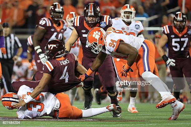 Jerod Evans of the Virginia Tech Hokies is tackled during the ACC Championship against the Clemson Tigers on December 3 2016 in Orlando Florida