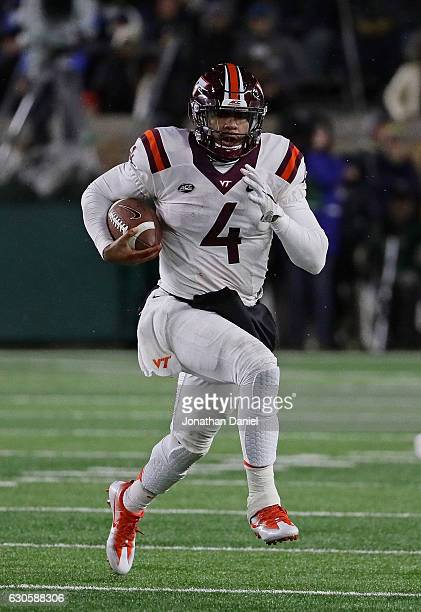 Jerod Evans of the Virginia Tech Hokies runs for a first down against the Notre Dame Fighting Irish at Notre Dame Stadium on November 19 2016 in...