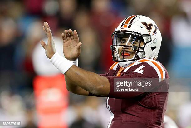 Jerod Evans of the Virginia Tech Hokies signals to his team against the Arkansas Razorbacks during the Belk Bowl at Bank of America Stadium on...