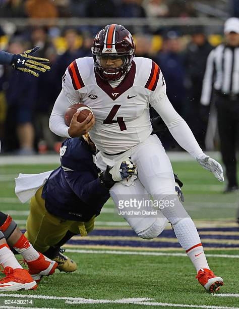 Jerod Evans of the Virginia Tech Hokies tries to break away from Isaac Rochell of the Notre Dame Fighting Irish at Notre Dame Stadium on November 19...
