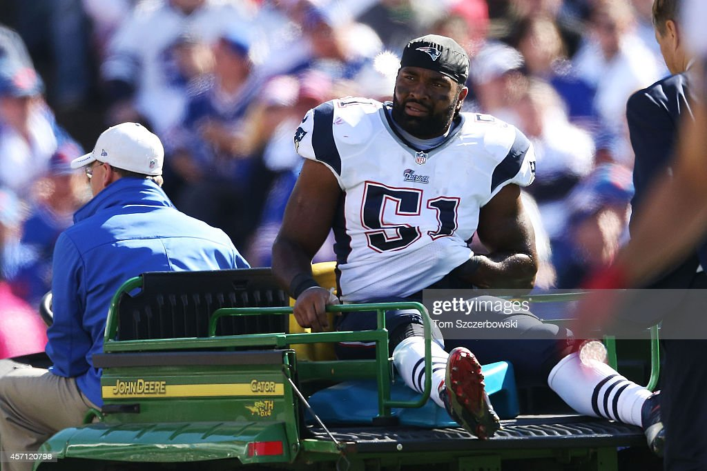 Jerod Mayo #51 of the New England Patriots is carted off the field after an injury against the Buffalo Bills during the first half at Ralph Wilson Stadium on October 12, 2014 in Orchard Park, New York.