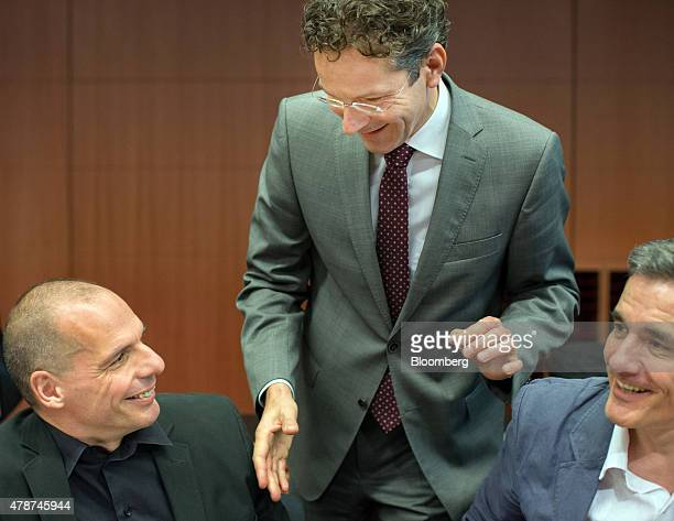 Jeroen Dijsselbloem Dutch finance minister and head of the group of euroarea finance ministers centre greets Yanis Varoufakis Greece's finance...