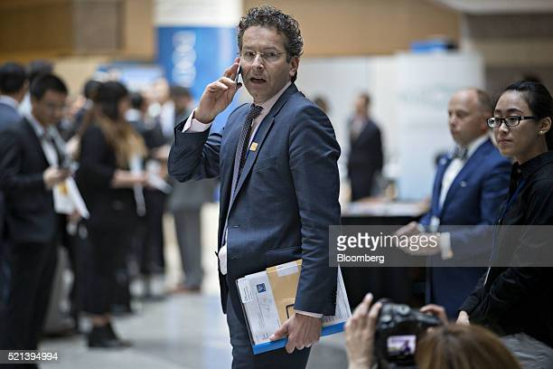 Jeroen Dijsselbloem Dutch finance minister and head of the group of euroarea finance ministers talks on a mobile phone during a Group of 20 finance...