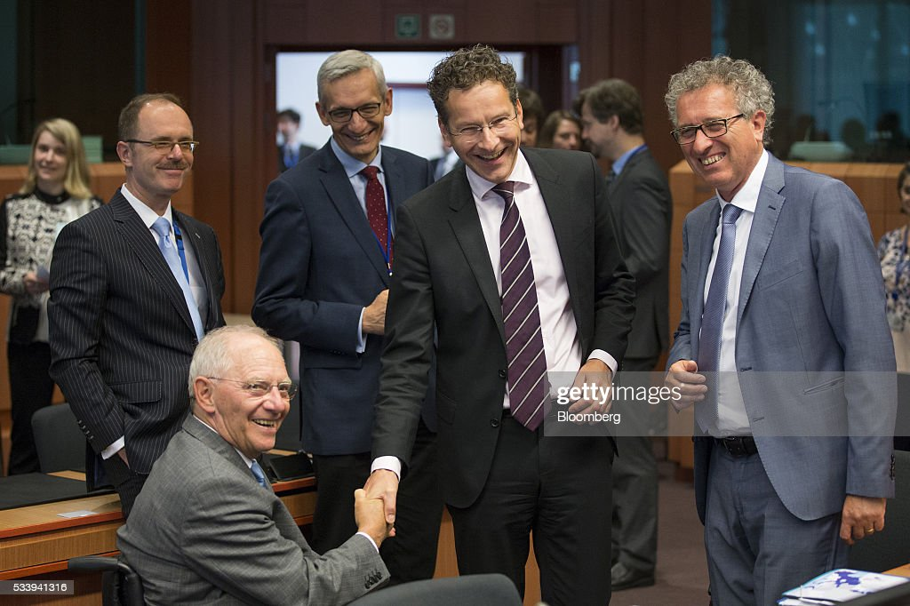 <a gi-track='captionPersonalityLinkClicked' href=/galleries/search?phrase=Jeroen+Dijsselbloem&family=editorial&specificpeople=9751962 ng-click='$event.stopPropagation()'>Jeroen Dijsselbloem</a>, Dutch finance minister and head of the group of euro-area finance ministers, center, shakes hands with Wolfgang Schauble, Germany's finance minister, during a Eurogroup meeting of European finance ministers in Brussels, Belgium, on Tuesday, May 24, 2016. Five years after handing Greece the biggest sovereign-debt write-off in history, European policy makers have come full circle to the point they had all hoped to avoid: a real discussion on debt relief. Photographer: Jasper Juinen/Bloomberg via Getty Images