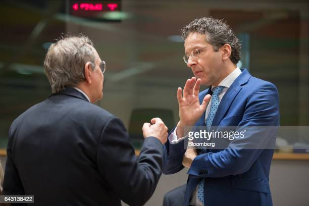 Jeroen Dijsselbloem Dutch finance minister and head of the group of euroarea finance ministers right gestures while speaking to Pier Carlo Padoan...