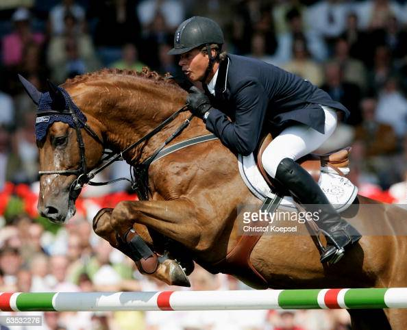 Jeroen Dubbeldam of the Netherlands jumps on BMC Nassau in the discipline of show jump of the S16 Great Pirce of Aachen during the CHIO Aachen 2005...