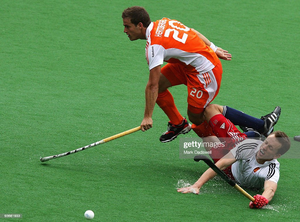 Jeroen Hertzberger of the Netherlands clashes with Dan Fox of England in the match between England and the Netherlands during day four of the 2009...