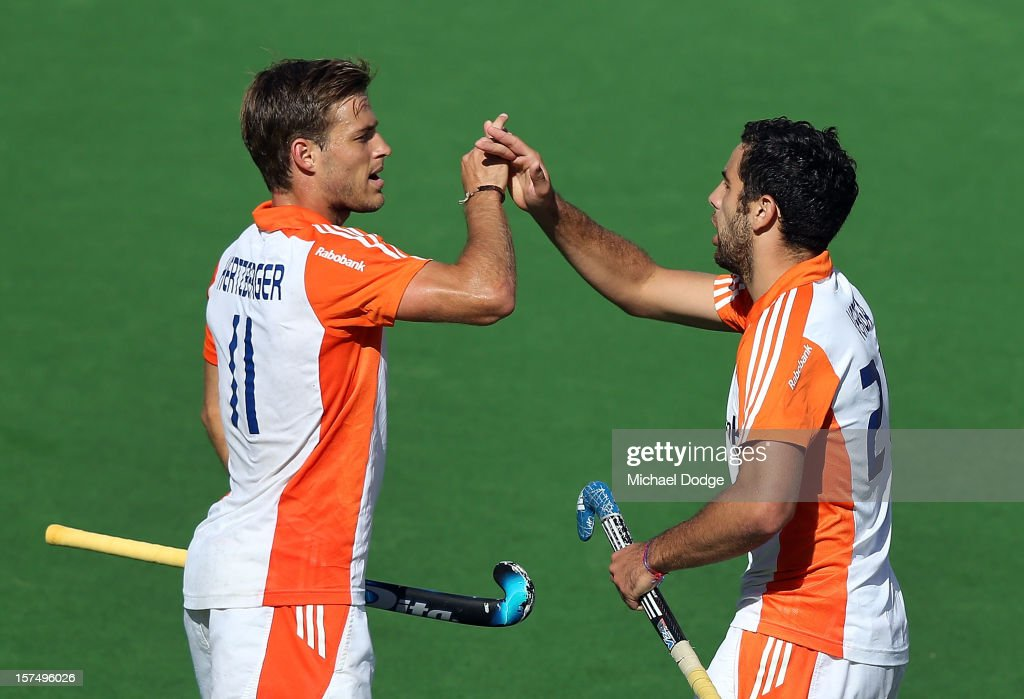 Jeroen Hertzberger of the Netherlands scores a goal and celebrates with Valentin Verga Belgium of the Netherlands in the match between the Netherlands and Belgium during day three of the Champions Trophy at State Netball Hockey Centre on December 4, 2012 in Melbourne, Australia.