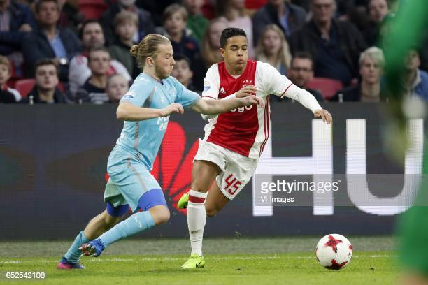 Jeroen van der Lely of FC Twente Justin Kluivert of Ajaxduring the Dutch Eredivisie match between Ajax Amsterdam and FC Twente Enschede at the...