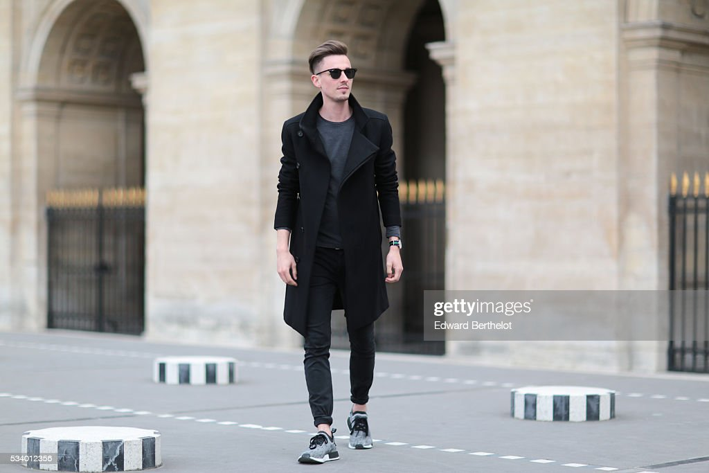 Jeroen Van Es, is wearing gray Adidas Originals shoes, Diesel black pants, an All Saints gray shirt, an All Saints black coat, Rayban sunglasses, and a Daniel Wellington watch, during a street style session, at Palais Royal, in the 1st quarter of Paris, on May 24, 2016 in Paris.