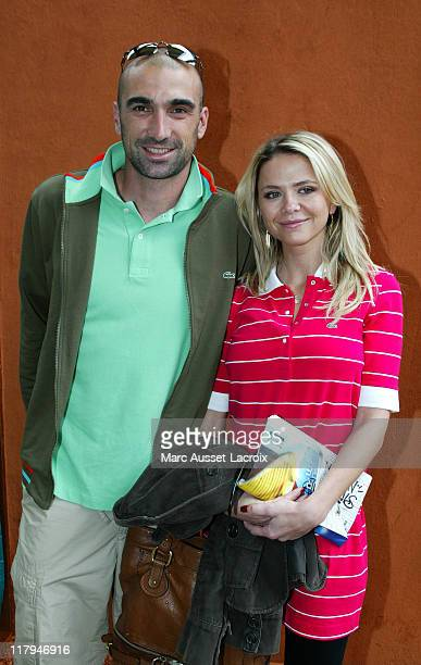 Jerome Alonso and his wife pose in the 'Village' the VIP area of the French Open at Roland Garros arena in Paris France on June 1 2007