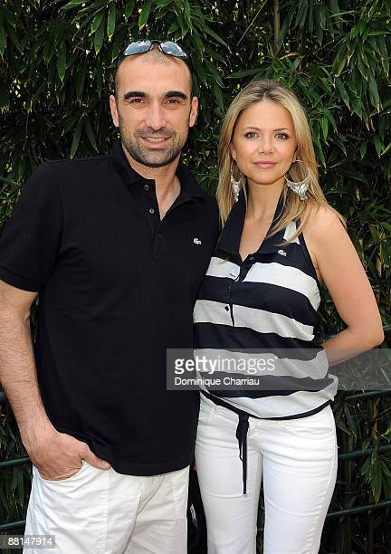 Jerome Alonzo and Guest attend The French Open 2009 at Roland Garros Stadium on June 1 2009 in Paris France