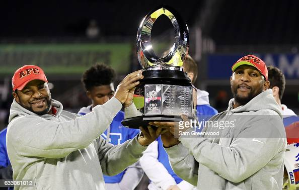 Jerome Bettis and Ray Lewis pose with the tophy after the AFC defeated the NFC 20 to 13 during the NFL Pro Bowl at the Orlando Citrus Bowl on January...