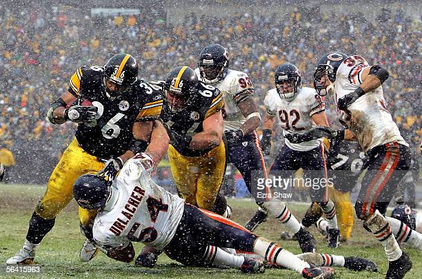 Jerome Bettis of the Pittsburgh Steelers runs over Brian Urlacher the Chicago Bears for a touchdown on December 11 2005 at Heinz Field in Pittsburgh...