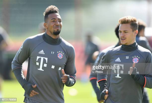 Jerome Boateng and Joshua Kimmich warm up during a training session of FC Bayern Muenchen on April 24 2017 in Munich Germany