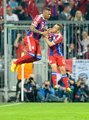 Jerome Boateng and Rafinha of Munich celebrate scoring their team's second goal during the UEFA Champions League quarter final second leg match...
