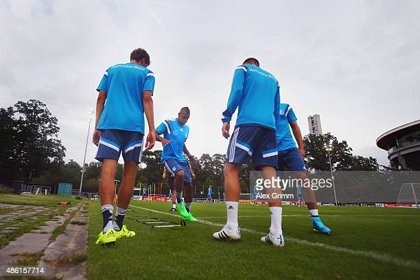 Jerome Boateng and team mates attend a Germany training session at 'Kleine Kampfbahn' training ground on September 1 2015 in Frankfurt am Main Germany