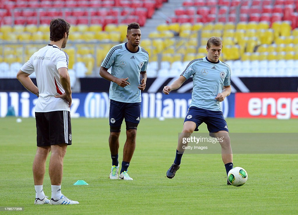 Jerome Boateng and Toni Kroos of Germany in action during a Germany Training Session at Allianz Arena Munich on September 5, 2013 in Munich, Germany.