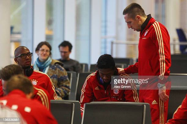 Jerome Boateng David Alaba and Franck Ribery of Muenchen wait for their team's departure to the training camp in Doha at Munich airport on January 2...